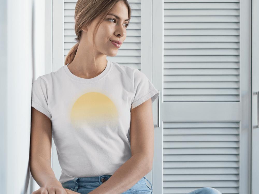 woman wearing white t-shirt with sunrise print
